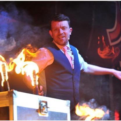 JezO performing an illusion with fire