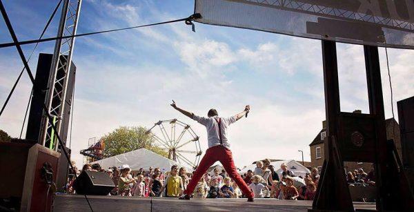 Jezo on stage at village fair